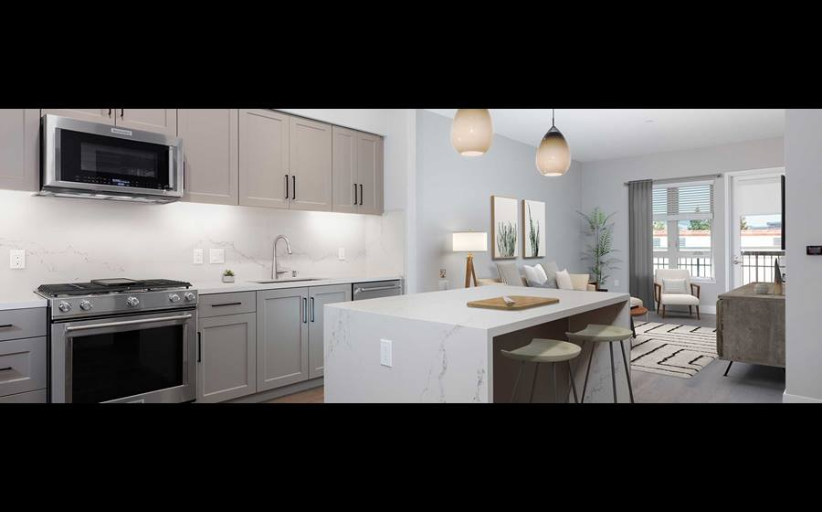 Phase II Signature Collection Kitchen and dining area with grey cabinetry, white marble countertops and backsplash, upgraded stainless steel appliances, and hard surface flooring