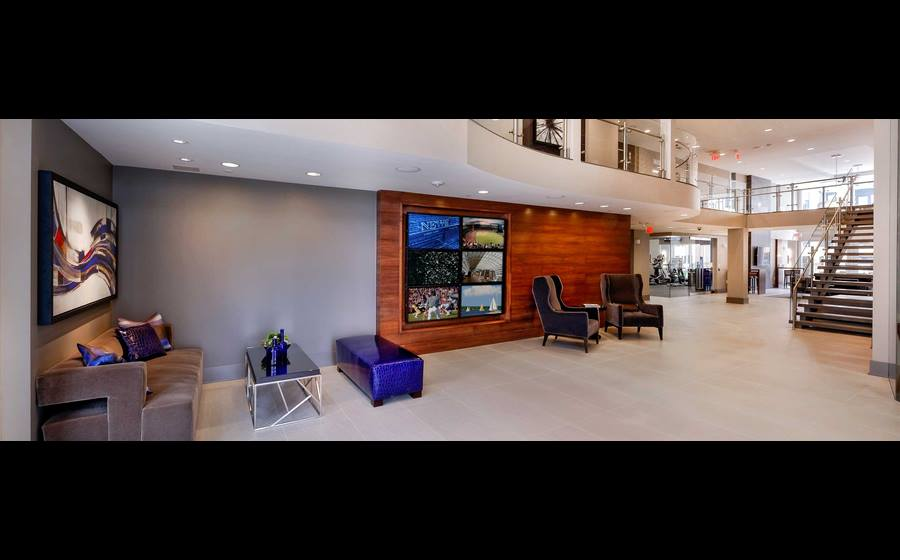 Lobby with flat screen televisions and seating