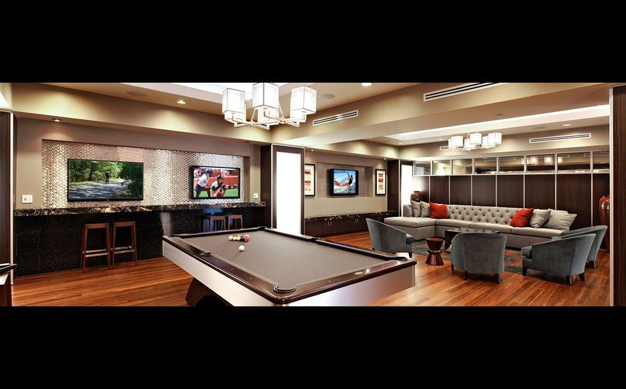 Resident lounge with billiards, flat screen televisions and seating