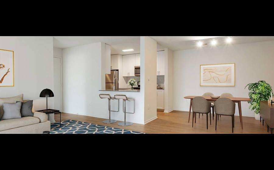 Newly renovated Finish Package II kitchen, living, and dining areas with hard surface flooring